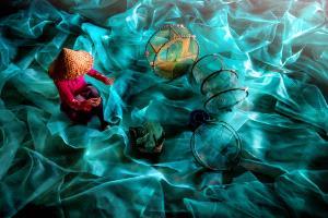 TPC Merit Award - Chin Leong Teo (Singapore)  Lady Mending Fishing Nets